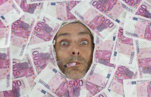 Mister Euro smoking a 500 euro notes